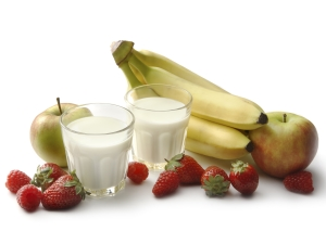 Fruit and glasses of milk