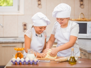 Two girls in the kitchen cooking