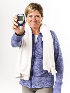 Woman holding glucometer